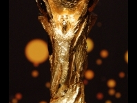 FIFA stakes 18-carat gold cup in South Africa soccer sun splash